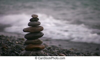 hand making pyramid on beach - Hand making pyramid on beach