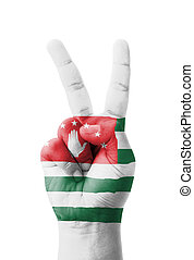 Hand making the V sign, Abkhazia flag painted