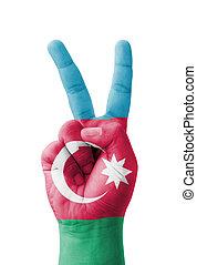 Hand making the V sign, Azerbaijan flag painted