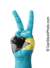 Hand making the V sign, Bahamas flag painted
