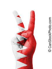 Hand making the V sign, Bahrain flag painted