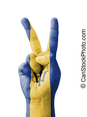 Hand making the V sign, Barbados flag painted
