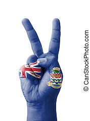 Hand making the V sign, Cayman Islands flag painted