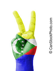 Hand making the V sign, Comoros flag painted