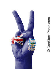 Hand making the V sign, Falkland Islands flag painted