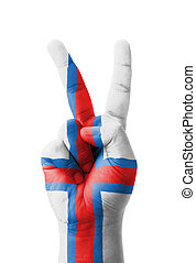 Hand making the V sign, Faroe Islands flag painted