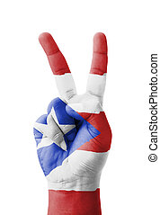 Hand making the V sign, Puerto Rico flag painted as symbol...