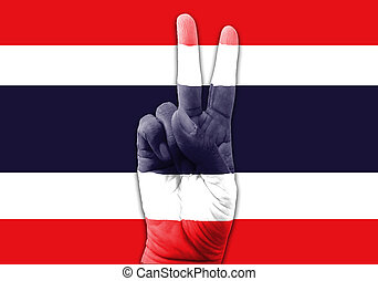 Hand making the V sign, Thailand flag painted as symbol of victory, win, success.