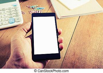 Hand man holding smart phone vintage style