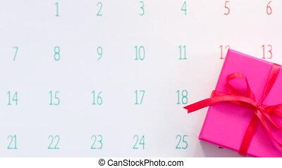 Hand marking celebration day on calendar page