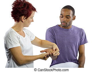 Hand Massage - young female masseuse applying pressure on...