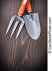 Hand metal working tools with handles on vintage wooden board co