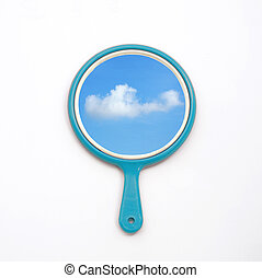 hand mirror with reflection of blue sky and cloud isolate on white