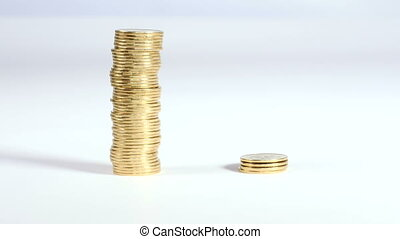 Hand moves coins from one pile to another