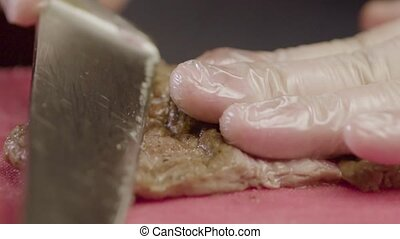 Hand O? Chef Cuts A Piece Of Appetizing Meat - Slow Motion -...