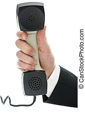 Hand of a businessman holding telephone receiver