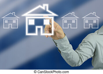 hand of a businessman pointing to a house symbol on blurred background of tall buildings.