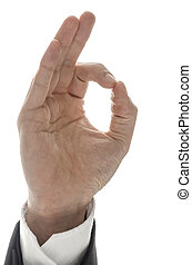 Hand of a businessman showing an Ok sign