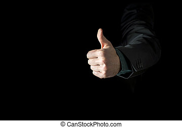 Hand of a businessman wearing black business suit showing thumb up