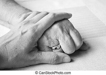 hand of a doctor and senior and senior patient