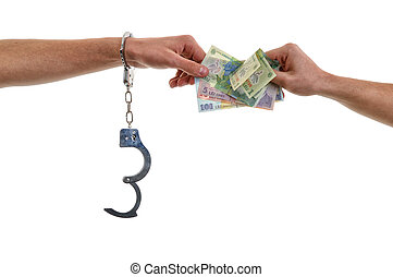 Hand of a man in handcuffs giving bribe