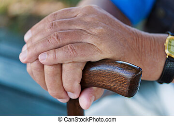 hand of a man with cane
