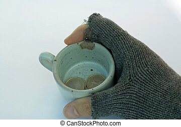 hand of a poor man holding a cup of almsgiving with coins