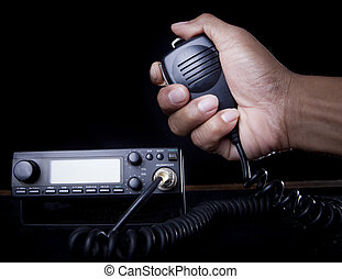 hand of Amateur radio holding speaker and press for radio ...