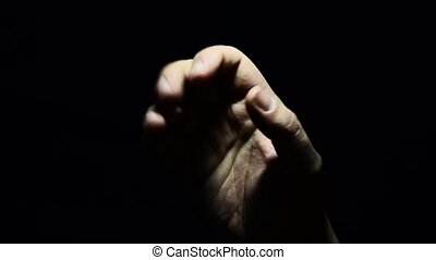 A helping hand in a difficult momen - hand of an adult and...