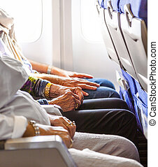 hand of an elderly lady sitting in the aircraft