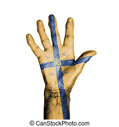 Hand of an old woman, wrapped with a pattern of the banner of the kingdom of Holland, isolated on white