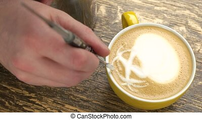 Hand of barista and coffee. Palm trees latte art.