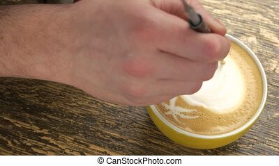 Hand of barista and latte.