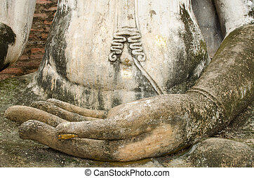 hand of buddhism image in Sukhothai historical park