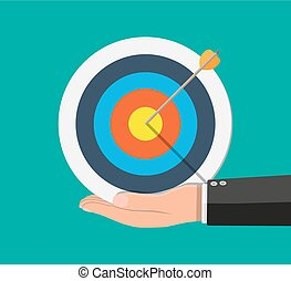 Hand of businessman pointing to arrow from target
