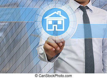Hand of businessman use finger touch icon home.
