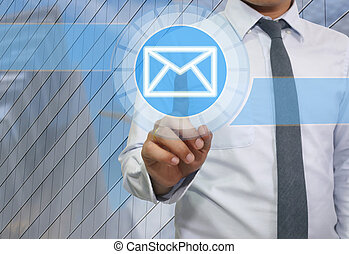 Hand of businessman use finger touch icon of envelope or e-mail system.