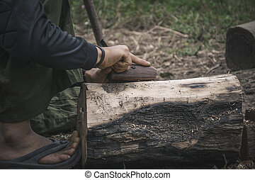 hand of carpenters using spokeshave to decorate trunk for the woodwork