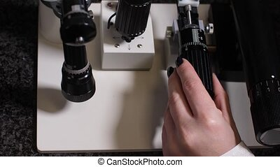 Hand of embryologist using microscope during work - Close-up...