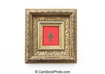 hand of fatima in decorative golden frame