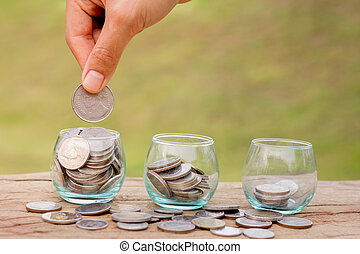 Hand of female putting coins in jar with money stack step growing growth saving money