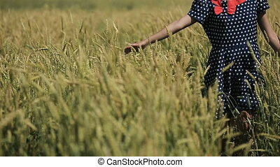 Hand of girl in the wheat field.