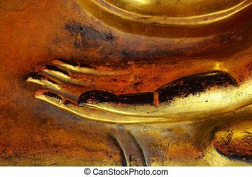 Hand of golden buddha image