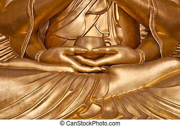 Hand of golden buddha statue meditation