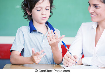 Hand of kid learning math with teacher