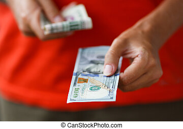 Hand of man giving money