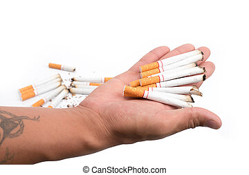 hand of man holds a cigarette in his hand. In order to stop smoke cigarettes is addictive. Health Concepts and Non-Smoking Day
