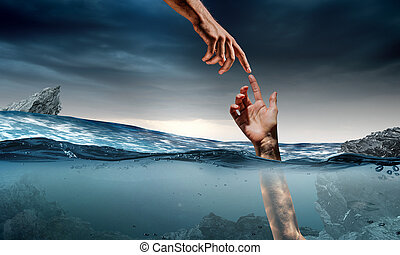 Hand of person drowning in water - Man drowning in sea and...