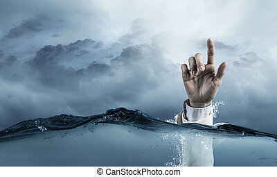 Hand of person drowning in water