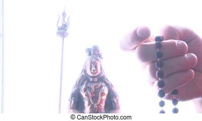 Hand of prayer holding rudraksha japamala - Hand of prayer...